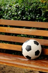 Football on benchvertical composition relax concept